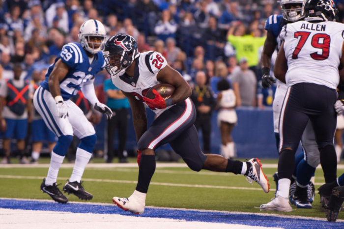 INDIANAPOLIS, IN - DECEMBER 11: Houston Texans running back Lamar Miller (26) scores a touchdown on a short run during the NFL game between the Houston Texans and Indianapolis Colts on December 11, 2016, at Lucas Oil Stadium in Indianapolis, IN. (Photo by Zach Bolinger/Icon Sportswire)